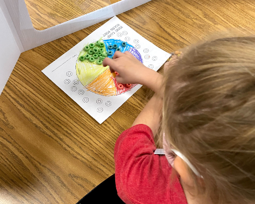 Child doing color activity